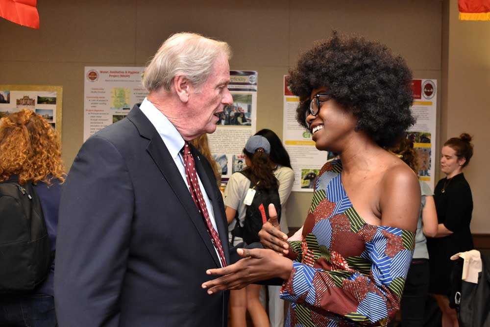 President Thrasher at IE reception talking to a student