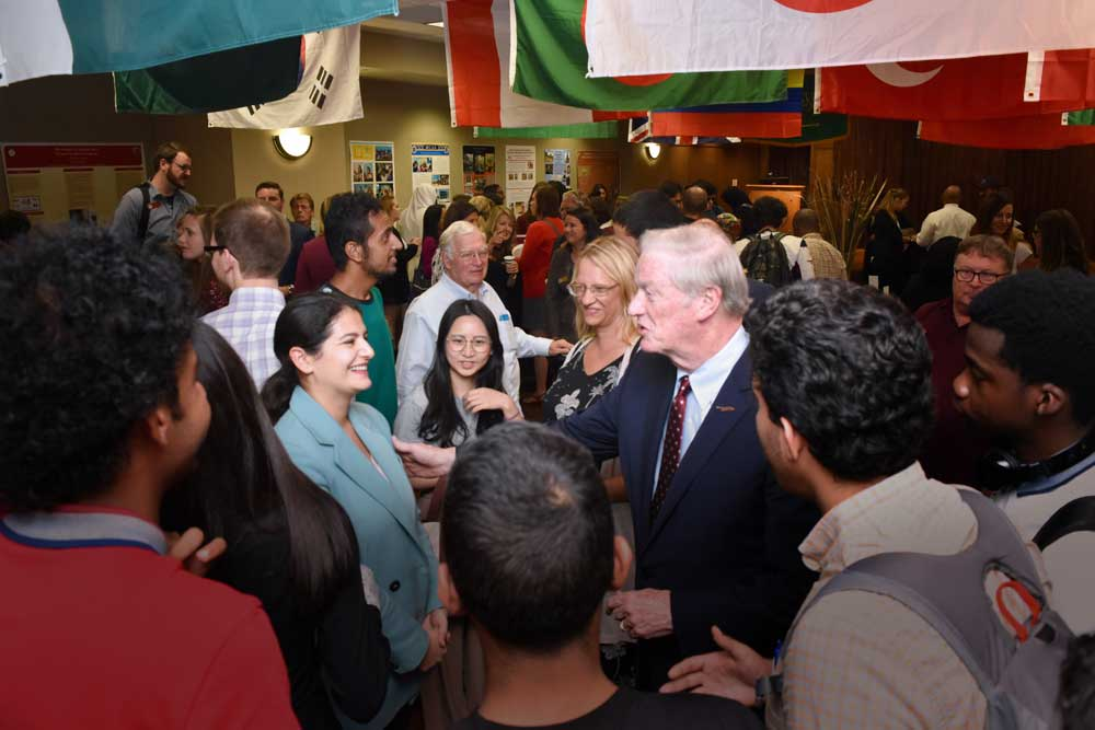 President Thrasher addressing audience at IEW opening reception